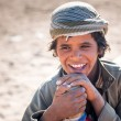 Boy working with camels in Bedouin village on the desert — Stock Photo