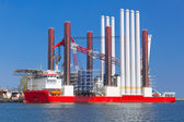Shipyard in Gdynia with wind turbine installation vessel — Stock Photo