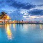 Sunset at swimming pool — Stock Photo
