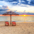 Sunset under parasol on the beach — Stock Photo #26871083