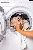 Loading laundry to the washing machine — Stock Photo