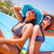 Relax of two tanned girls — Stock Photo