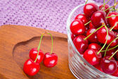 Red cherries in the bowl — Stock Photo