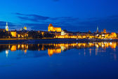 Torun old town at night reflected in the river — Stock Photo