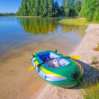 Stock Photo: Inflatable dinghy at summer lake