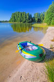 Inflatable dinghy at the summer lake — Stock Photo