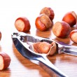 Hazelnuts with nutcracker — Stock Photo