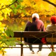 Senior couple sitting on bench — Stok fotoğraf