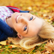 Beautiful woman at the autumnal park — Stock Photo #35833923