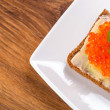 Sandwich with red caviar — Stock Photo