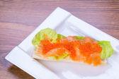 Caviar and smoked salmon sandwich — Stock Photo
