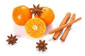 Orange fruit, cinnamon sticks and anise stars — Stock Photo