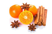 Orange fruit, cinnamon sticks and anise stars — Stock Photo