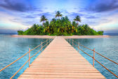 Pier to the tropical island — Stock Photo