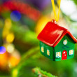 House shape bauble on christmas tree — Stok fotoğraf