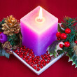 Christmas candle with decorations — Stock Photo