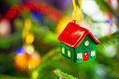 House shape bauble on christmas tree — Stock Photo