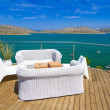 Постер, плакат: White sofas with Mirabello Bay view
