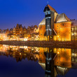 Old town of Gdansk with ancient crane at night — Stock Photo #39779717