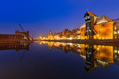 Old town of Gdansk with ancient crane at night — Stock Photo