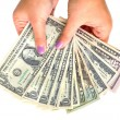 Dollar banknotes in female hand — Stock Photo