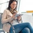 Businesswoman with internet tablet on the airport — Stock Photo #44934463