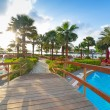Sunrise at the tropical swimming pool — Stock Photo #44935299