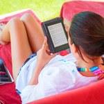 Reading on e-book on summer holidays — Stock Photo #46666089