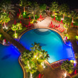 Tropical pool area at night — Stock Photo