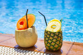 Tropical drinks at the pool — Stock Photo