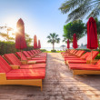 Empty red deckchairs at the sea — Stok fotoğraf