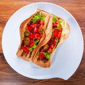 Mexican tacos in tortilla shells — Stock Photo