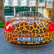 ������, ������: Panther paint Bentley parked outside the Hilton Dubai Hotel
