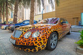 Panther paint Bentley parked outside the Hilton Dubai Hotel — Foto de Stock