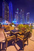 Restaurant table at Dubai Marina at night — Stock Photo