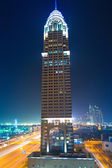 The Al Kazim Towers in Dubai Media City at night — Stock Photo