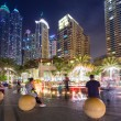 Постер, плакат: Promenade in Dubai Marina at night UAE
