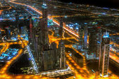 Panorama of city centre in Dubai at night, UAE — Stock Photo