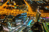 Panorama of city centre in Dubai at night, UAE — Stock Photo
