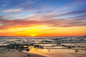 Sunset on the beach at Baltic Sea — Stock Photo