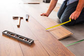 New wooden floor instalation — Stock Photo
