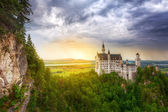 Neuschwanstein Castle in the Bavarian Alps at sunset — Stock Photo