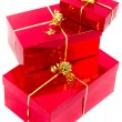 Red gift boxes with golden ribbon — Stock Photo #8060483