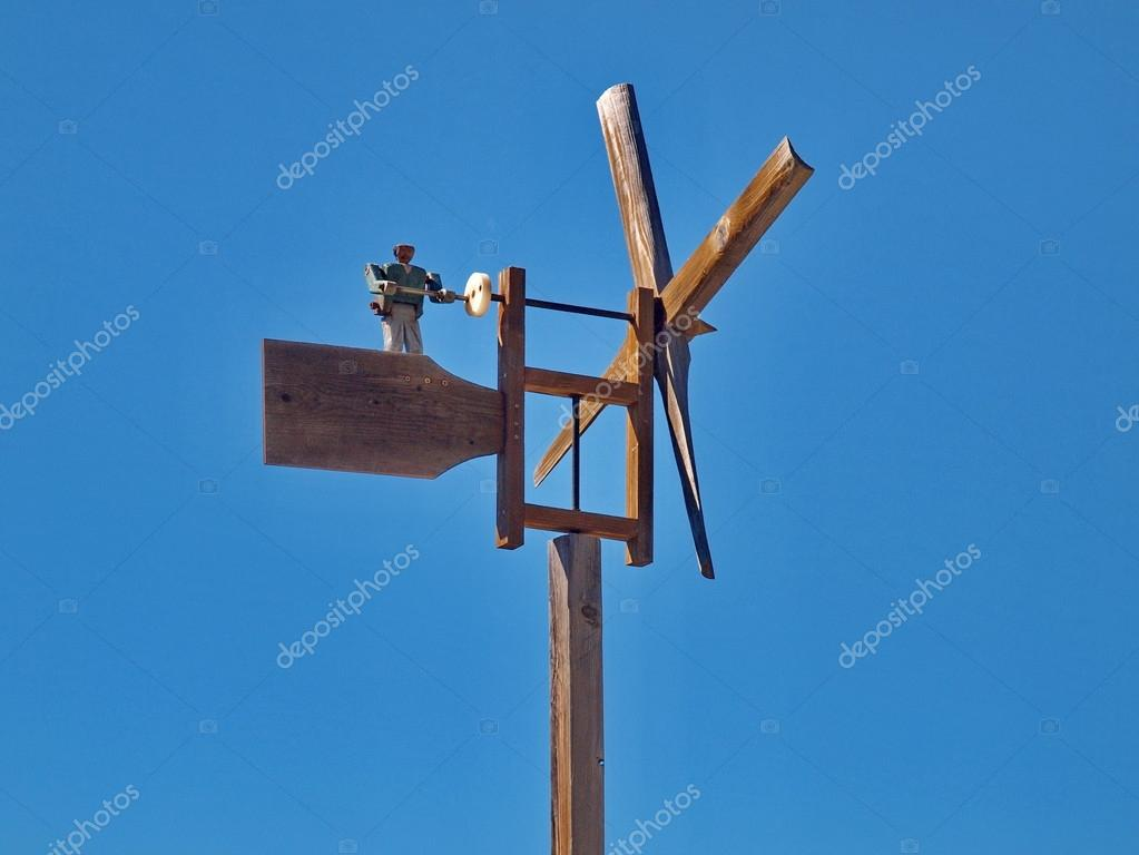 Wooden windmill with figure — Stock Photo #16218453