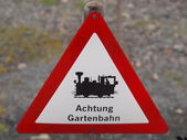 Warning sign garden railway — Stock Photo