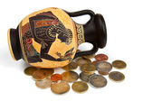 Greek amphora with coins — Stock Photo