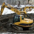Stock Photo: Excavator loader during earthmoving works - dredging pond