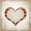 Photo: Vintage grunge background to a festive Valentine