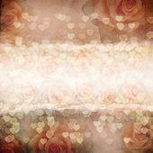 Antigo fundo de papel rasgado. textura com um rosas — Foto Stock