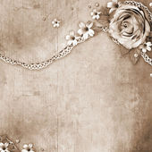 Vintage textured background with a bouquet of flowers, lace and — Stock Photo